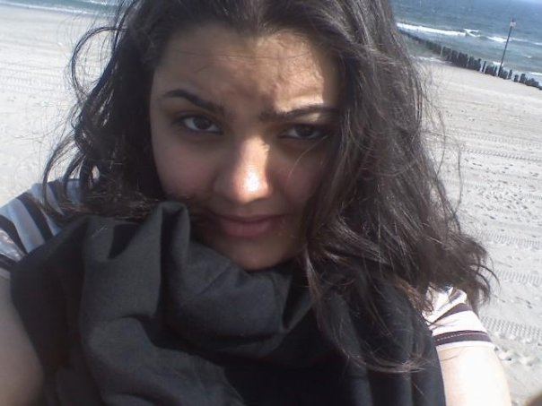 A picture of me taken a few years ago. At the beach... in May. Not summer weather yet. Yes,  I was freezing.